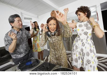 Multi-ethnic group of friends enjoying party