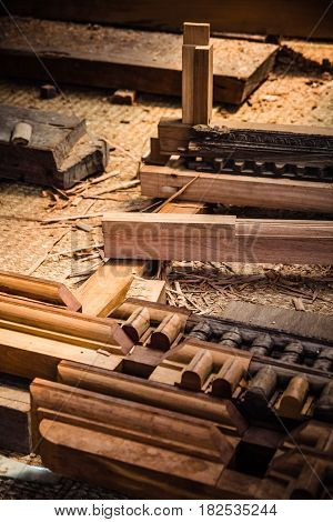 Wooden beams and carvings lay on the floor of a make shift workshop near Durbar Square Patan Nepal. Work on restoring the damage done in the 2015 earthquake which shook Nepal is still ongoing.