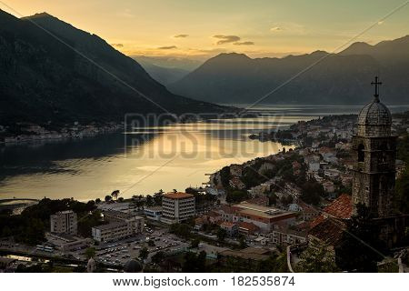 Panoramic top view sunset of Kotor and UNESCO old church , Montenegro, Europe travel destination. Boka Kotor bay Kotorska on Adriatic Sea, the preserved Venetian fortress, old towns and mountains.