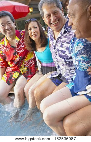 Multi-ethnic group of friends enjoying pool party