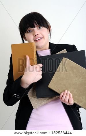 worried female student with books looking at camera on white background