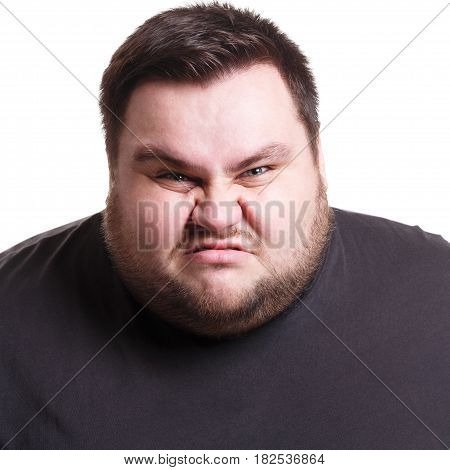 Angry fat man portrait, furious big guy expressing anger, white isolated studio background