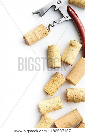 Corks and corkscrew isolated on white background.