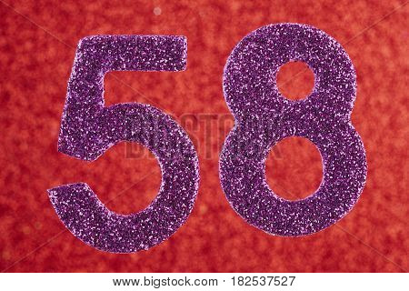 Number fifty-eight purple color over a red background. Anniversary. Horizontal