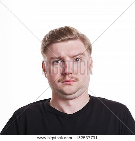 Feeling unpleasant surprised. Caucasian man grimacing to camera on white isolated background, studio shot, portrait