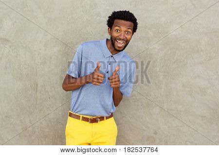 Smiling African American Man With Both Thumbs Up