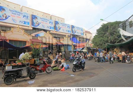 HANOI VIETNAM - NOVEMBER 23, 2016: Unidentified people visit Dong Xuan market in Old Quarter.