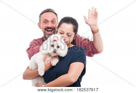 Cute Bichon Dog And His Owners