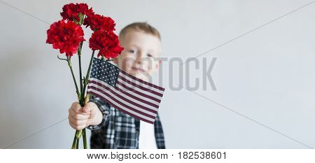 Kid With Flowers And American Flag