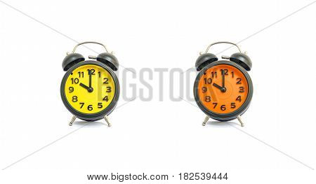 Closeup yellow alarm clock and orange alarm clock for decorate in 10 o'clock isolated on white background