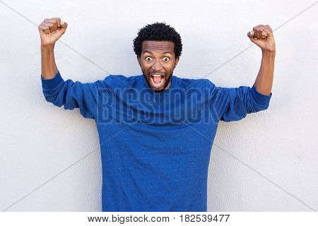 African American Man With Hands Raised In Shock And Disbelief