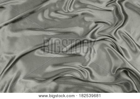 Gray wavy silk fabric close up image