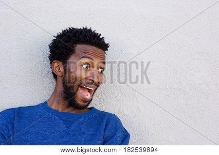 Close Up Handsome African American In Shock By White Wall