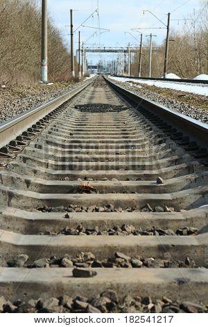 forward rails of railway go into distance