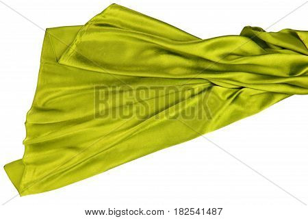 Yellow rippling silk fabric on white background