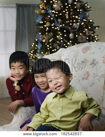 Korean children in livingroom at Christmas
