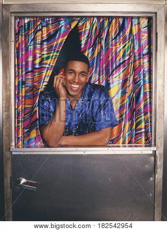 Man talking on cell phone in doorway