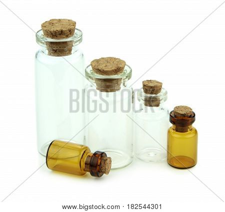 Small glass bottles with cork isolated on white background