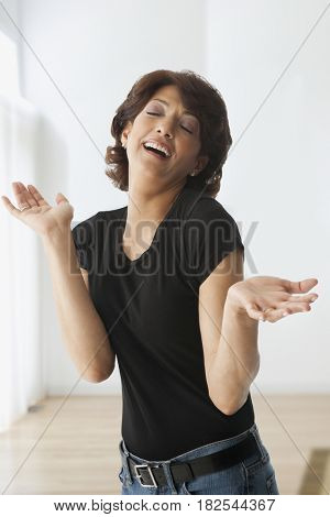 Hispanic woman shrugging