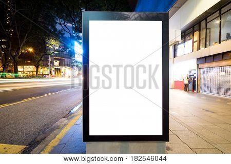 night scene of empty light box on street in modern city