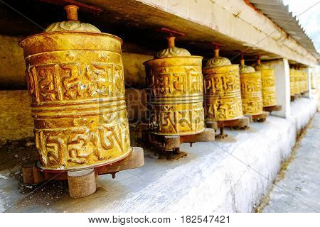 Prayer wheels at temples in Nepal people and tourists use to spin to pray lucky and calm.