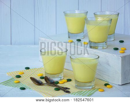 Yellow Dessert Junket From Milk And Rennet Extract With Turmeric In Glasses On Light Background. Jel