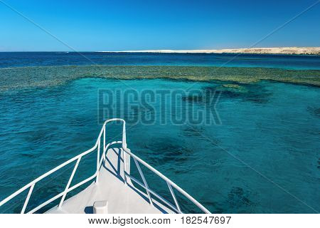View at the coral sea from white yacht. Perfect place for snorkeling. Summer vacation in Egypt. Red sea with clear turquoise water.