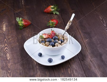 Healthy breakfast concept with oat flakes and fresh berries on rustic background. Healthy snack, fitness food, yogurt with musli and dried fruit, nutrition for weightloss, breakfast. Food made of granola and musli.