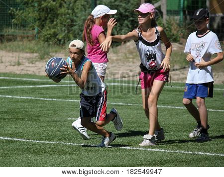 Unidentified Boy Runs With Ball