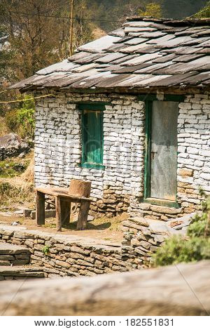 Nepal March 2017: A dwelling built using traditional techniques. Photographed just outside Birethanti in the Annapurna region Nepal.
