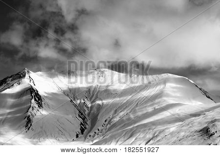 Black And White View On Off-piste Snow Slope In Evening