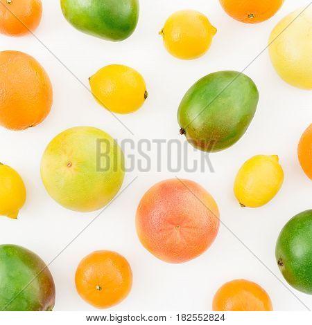 Lemon, orange, grapefruit, sweetie and tasty mango on white background. Flat lay, top view. Food background