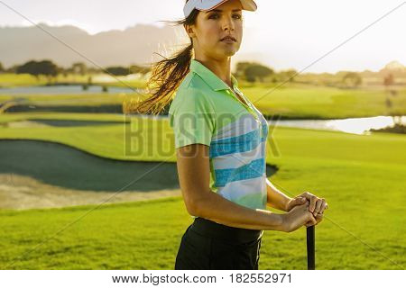 Young Female Golfer With Golf Club