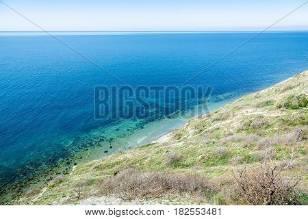 Blue sea and cliff in the Mediterranean. Summer day on sea