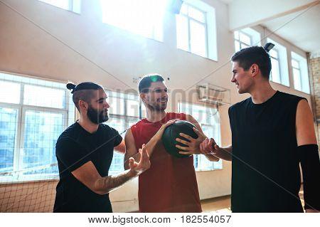 Shot of basketball teammates having fun indoors