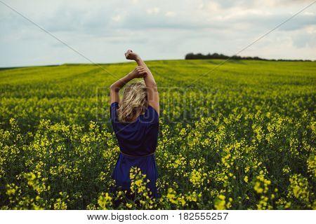 Carefree woman in rapeseed field