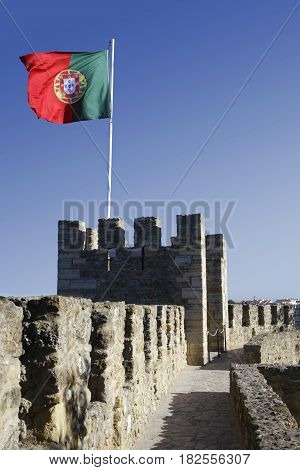 LISBON Portugal April 5 2017 : Saint George Castle (Castelo de Sao Jorge) is a strongly fortified citadel occupying a commanding hilltop overlooking the historic center of Lisbon and one of the main tourist sites of Lisbon.
