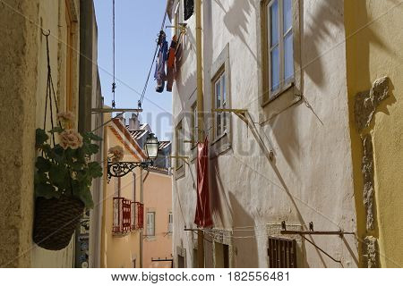 Lisbon, Portugal, April 5, 2017 : A Small Street In Alfama. Alfama Is The Oldest District Of Lisbon,