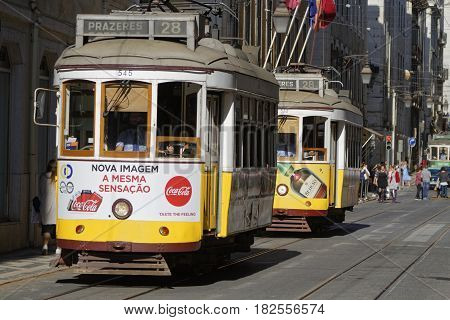 LISBON Portugal April 7 2017 : Tramway in Alfama district. The tramway network serves the capital city of Portugal since 1873. It presently comprises five remaining urban lines in the center