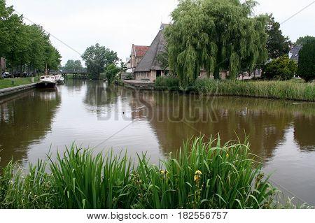 Friesland Franeker july 2016: Farmhousein the town of Franeker