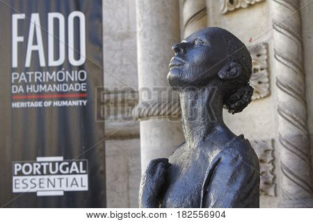 LISBON Portugal April 8 2017 : sculpture of Fado musician and dancer in Rossio station. In popular belief fado is a form of music characterized by mournful tunes and lyrics often about the sea or the life of the poor with a sentiment of resignation fatefu