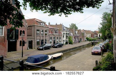 FrieslandFranekerjuly 2016: Canal in the town of Franeker