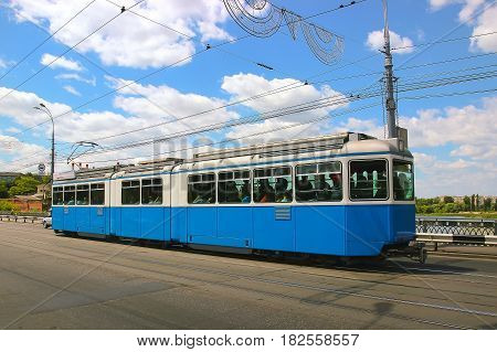 Daily life in the city. Tram of the public transport on the street