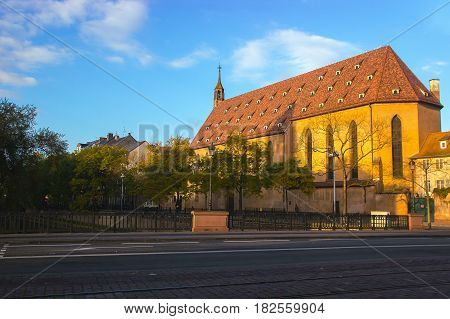 Colorful traditional french houses with great architecture near church