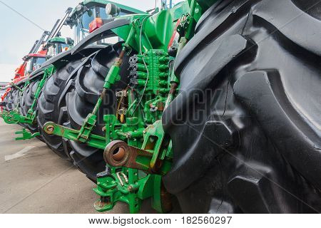 Agricultural tractors lined up in a row. Industry