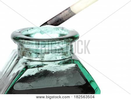 Quill pen and glass ink bottle ,on white background