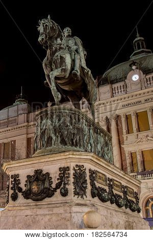 BELGRADE SERBIA - MARCH 18 2017: Night photo in the Republic Square (Trg Republike in Serbian) with old baroque style buildings statue of Prince Michael and the National Museum building.