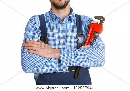 Plumber in blue uniform holding pipe wrench isolated on white