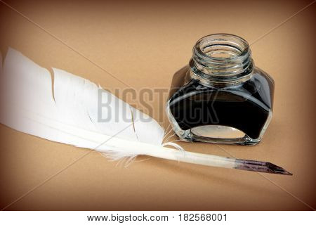 Quill pen and glass ink bottle,close up image