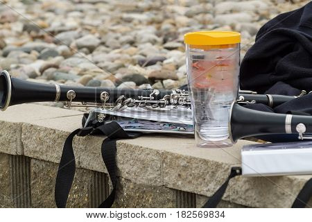 a resting place for music instruments jackets and water